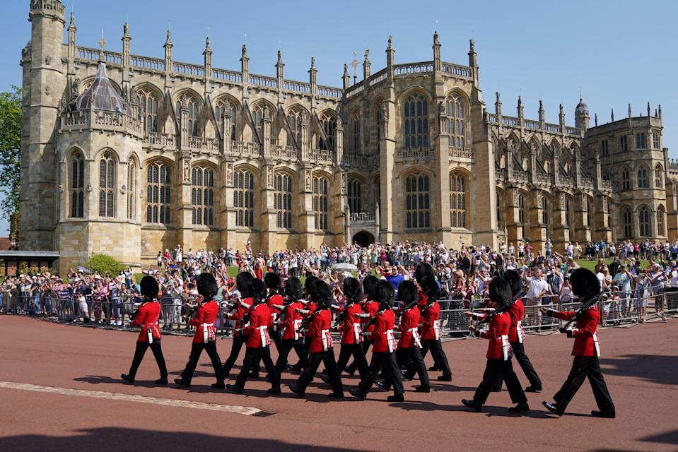 Members of the 1st Battalion Grenadier Guards arrive for the Changing of the Guard at Windsor Castle in Berkshire (Andrew Matthews/PA) (PA Wire)