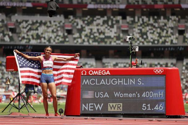 PHOTO: Gold medalist Sydney McLaughlin of Team United States poses in front of the scoreboard after setting a new world record in the Women's 400m Hurdles Final on day twelve of the Tokyo 2020 Olympic Games at Olympic Stadium on Aug. 04, 2021 in Tokyo. (Cameron Spencer/Getty Images)