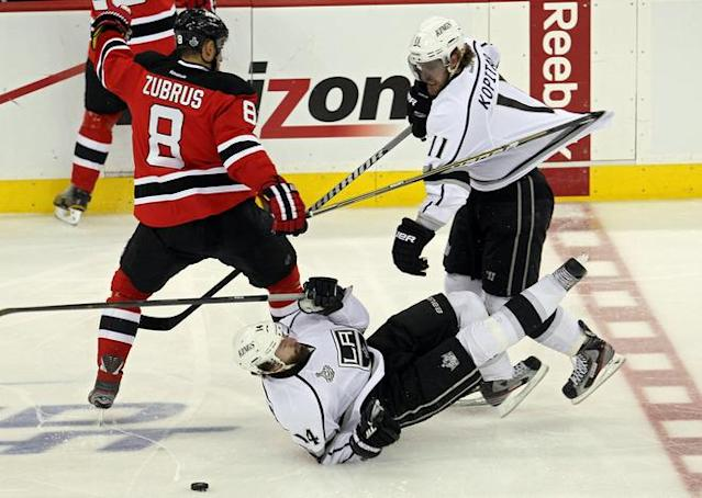 NEWARK, NJ - JUNE 09: Dainius Zubrus #8 of the New Jersey Devils fights for a loose puck with Justin Williams #14 and Anze Kopitar #11 of the Los Angeles Kings during Game Five of the 2012 NHL Stanley Cup Final at the Prudential Center on June 9, 2012 in Newark, New Jersey. (Photo by Jim McIsaac/Getty Images)