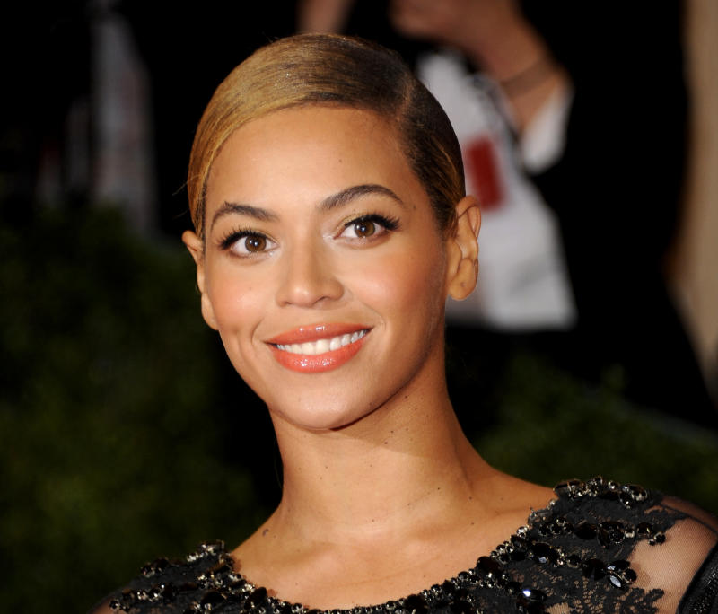 FILE - This May 7, 2012 file photo shows Beyonce Knowles at the Metropolitan Museum of Art Costume Institute gala benefit, celebrating Elsa Schiaparelli and Miuccia Prada in New York. Beyonce and Carole King are joining Oprah Winfrey and Alicia Keys at Keys' annual Black Ball event for Keys' charity Keep a Child Alive on Nov. 1, 2012 at New York's Hammerstein Ballroom. (AP Photo/Evan Agostini, File)