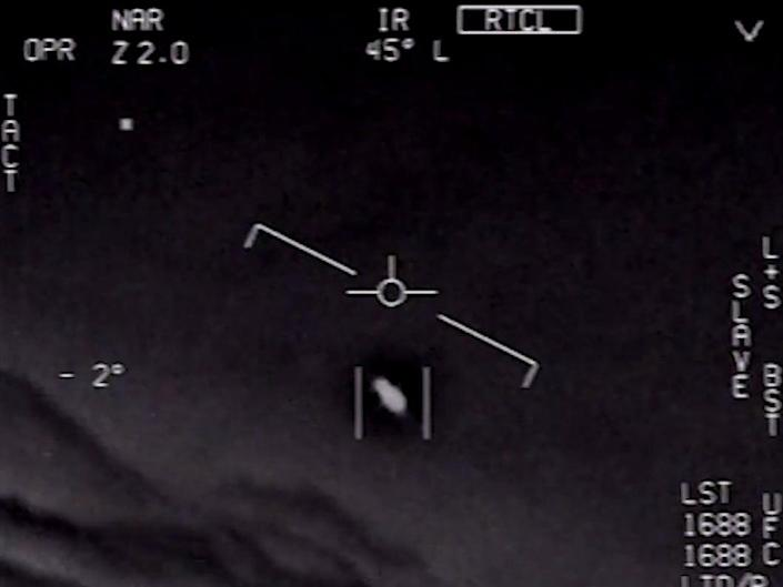 <p>The US Navy released a video earlier this year showing what appeared to be UFOs</p> ((US Navy))