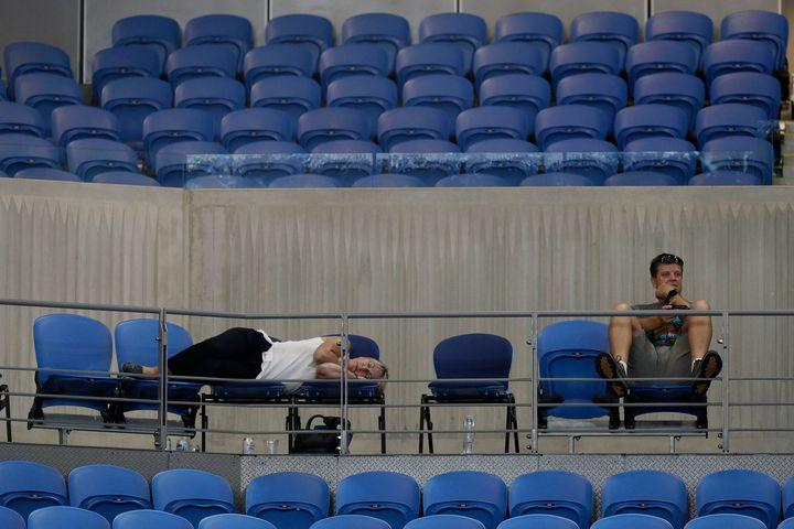 """The last time you were up past 3 a.m. was probably thanks to a big night out. Or binge-watching something on TV, we get it.  But spare a thought for these tennis fans, who stuck it out at the Australian Open as a match between Garbine Muguruza and Johanna Konta in the tournament's latest start ever.  SEE ALSO: Serena Williams' daughter's doll Qai Qai is the real star of the Australian Open  As per The Age, the match began just after 12.30am AEDT, thanks to daytime matches which ran overtime. Around 250 fans stuck around and watched on, and yeah, they looked tired.  Image: Julian Finney/Getty Images  Image: PETER PARKS/AFP/Getty Images  The match finally wrapped up at 3:12 a.m., with Muguruza beating Konta 6-4, 6-7 (3), 7-5. It's safe to say the players involved weren't so keen on the late start.  """"I don't agree with athletes having to physically exert themselves in the wee hours of the morning,"""" Konta told the BBC after the match.  """"I don't think it is healthy -- in fact it is quite dangerous ... However, Garbine and I were both in the same position and, with the circumstances, we really put on a great match and it's just a shame more people couldn't enjoy it.""""  It's not the latest finish to a match in the tournament's history, however, with that crown belonging to Lleyton Hewitt and Marcos Baghdatis in 2008. Their set finished at 4:34 a.m., after more than 4 hours and 45 minutes of play.  Even the longest match in modern tennis history, an eleven-hour marathon between John Isner and Nicolas Mahut at Wimbledon in 2010, was broken up over two days.  Anyway, here are some more tired-looking fans we can't help but admire.  Image: PETER PARKS/AFP/Getty Images  Image: PETER PARKS/AFP/Getty Images  The clock at 03.12 a.m.  Image: Julian Finney/Getty Images  ## WATCH: Nike's """"grass sneaker"""" will make your swing look cool"""