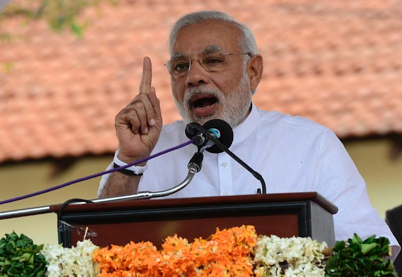 Indian Prime Minister Narendra Modi speaks during a ceremony to hand over Indian-funded houses to Tamils displaced or made destitute by fighting in Jaffna, on March 14, 2015 (AFP Photo/Lakruwan Wanniarachchi)