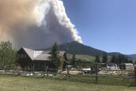 In this photo provided by Jim Bentler, the Robertson Draw fire is seen burning south of Red Lodge, Mont., on Tuesday, June 15, 2021. Authorities warned of extreme wildfire danger in Montana and Wyoming Tuesday as a sweltering heat wave was forecast to intensify across large parts of the two states after already delivering record high temperatures. (Jim Bentler via AP)