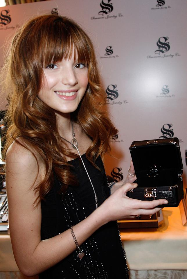 Bella's just 13 years old here, posing at a Simmons Jewelry Co. displayat the Four Seasons in L.A.