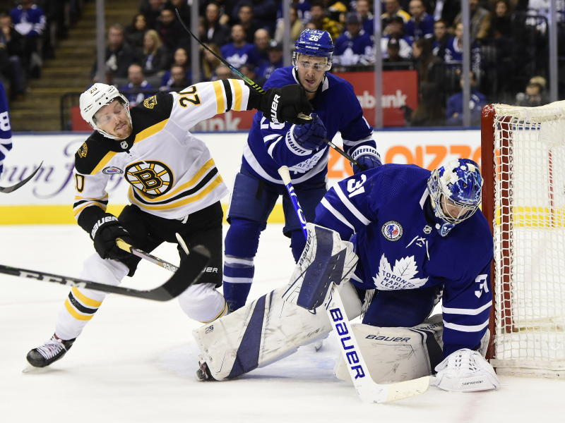 Toronto Maple Leafs goaltender Frederik Andersen (31) covers the puck as center Nicholas Shore (26) defends against Boston Bruins centrer Joakim Nordstrom (20) during the third period of an NHL hockey game Friday, Nov. 15, 2019, in Toronto. (Frank Gunn/The Canadian Press via AP)