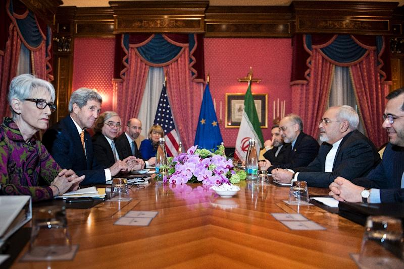 US Secretary of State John Kerry (2nd-L), head of the Iranian Atomic Energy Organisation Ali Akbar Salehi (3rd-R) and Iranian Foreign Minister Javad Zarif (2nd-R) and others meet in Lausanne, Switzerland, on March 26, 2015