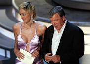 Sharon Stone and William Shatner present the award for outstanding writing for a drama series during the 56th Annual Primetime Emmy Awards Sunday, Sept. 19, 2004, at the Shrine Auditorium in Los Angeles. (AP Photo/Kevork Djansezian)
