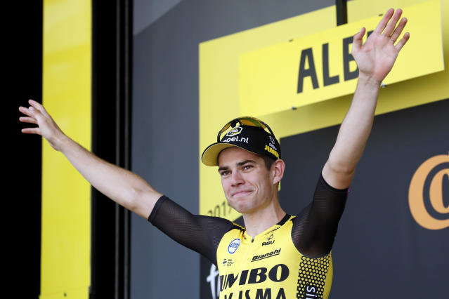 Belgium's Wout Van Aert celebrates on the podium after he won the tenth stage of the Tour de France cycling race over 217 kilometers (135 miles) with start in Saint-Flour and finish in Albi, France, Monday, July 15, 2019. (AP Photo/ Christophe Ena)