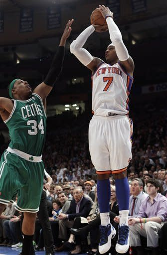New York Knicks' Carmelo Anthony (7) shoots over Boston Celtics' Paul Pierce (34) during the first half of an NBA basketball game Tuesday, April 17, 2012, in New York. (AP Photo/Frank Franklin II)