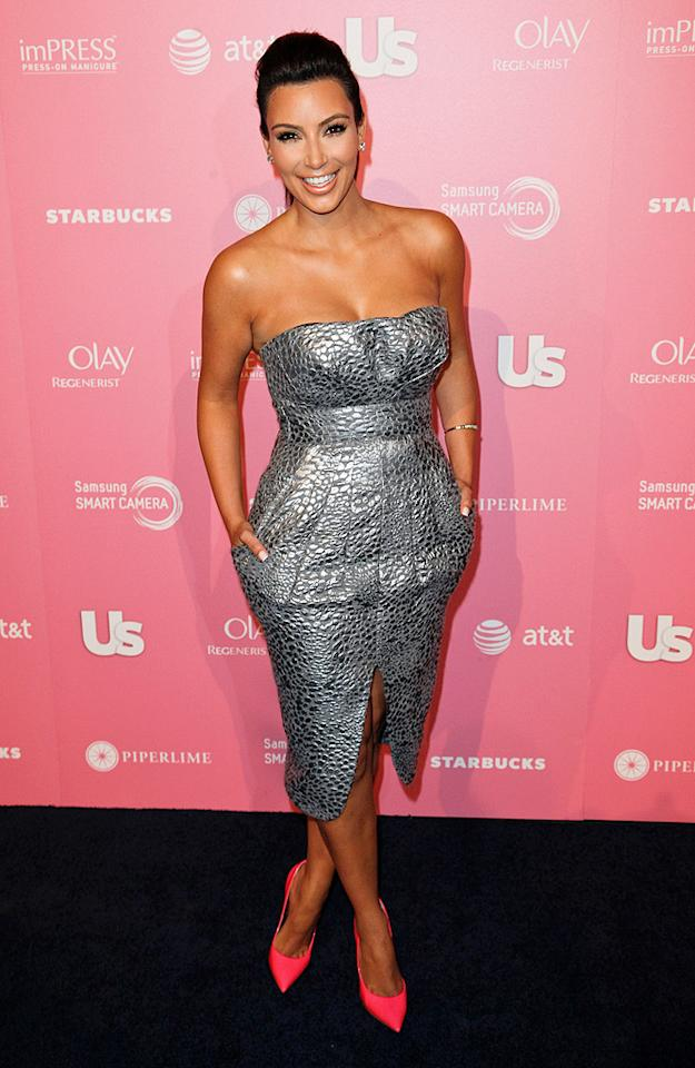 Love her or hate her (or really really hate her!), you have to give Kim Kardashian credit for cleaning up well at this year's <em>Us Weekly</em> Hot Hollywood soiree. Do you prefer the reality star's silver Catherine Malandrino dress or her hot pink Cadadei heels? We can't decide! (4/18/2012)