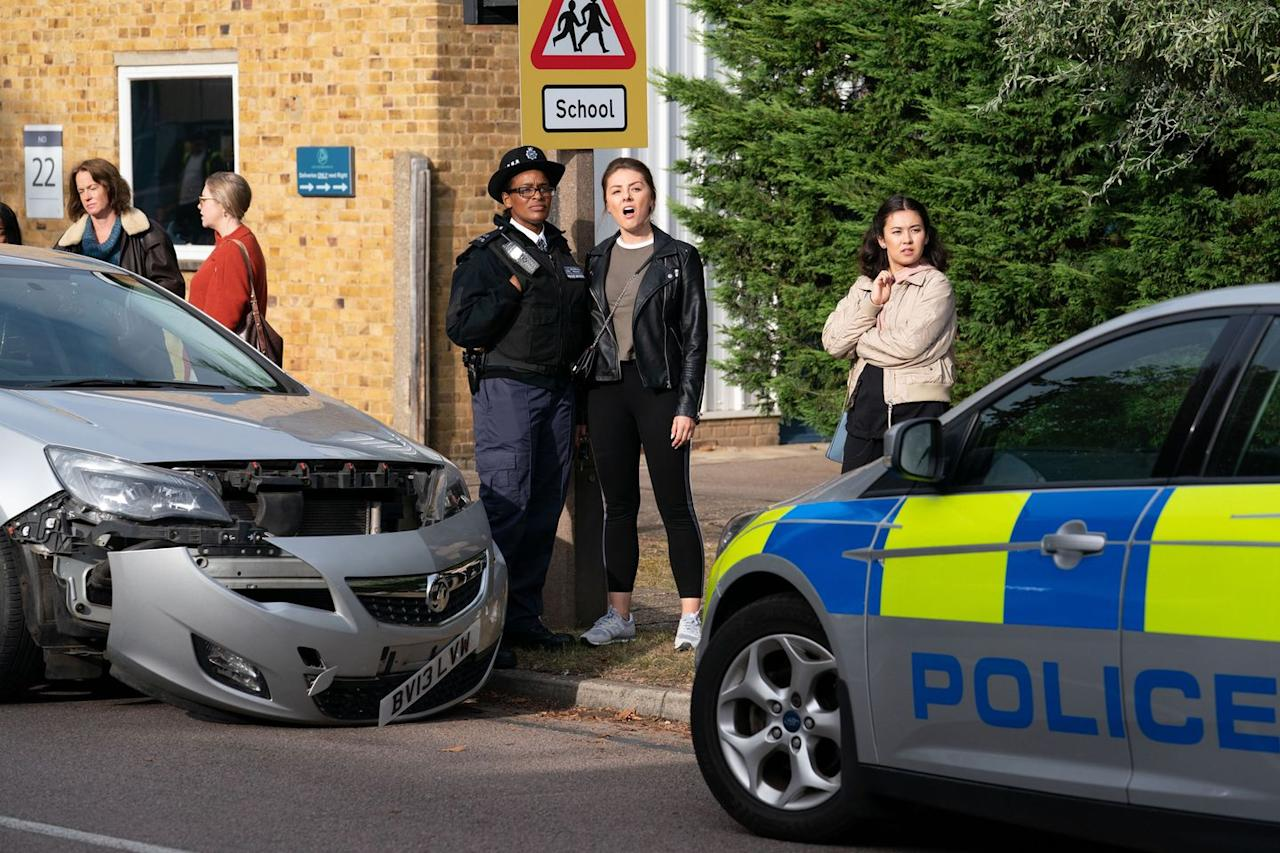 <p>Police wait for her at the school after she accidentally backed into another car and drove away.</p>