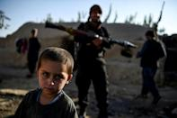 The village of Aziz Abad sits on the frontline of Afghanistan's war and has seen renewed fighting between government forces and Taliban in recent weeks