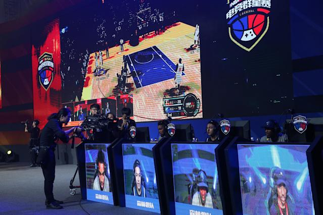 "Karl-Anthony Towns of the <a class=""link rapid-noclick-resp"" href=""/nba/teams/min/"" data-ylk=""slk:Minnesota Timberwolves"">Minnesota Timberwolves</a> participates in an October 2017 ""NBA 2K"" esports event in Shenzhen, China. The NBA's big foray into esports, the NBA 2K League, is set to debut in 2018. (Joe Murphy/NBAE/Getty)"