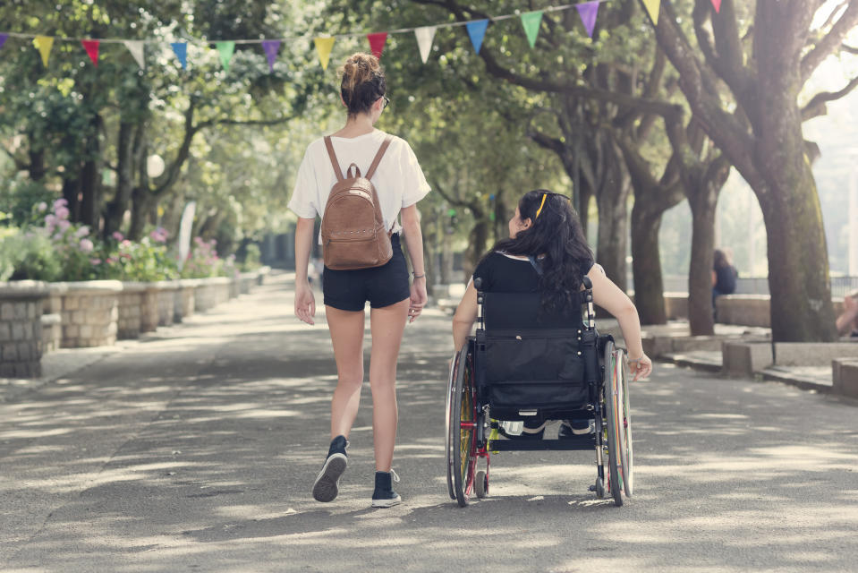 A woman was mocked for standing up without her wheelchair [Photo: Getty]