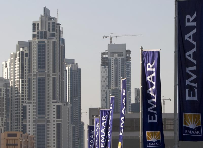 Flags for property company EMAAR, builders of Burj Dubai the world's tallest tower, are seen in Dubai