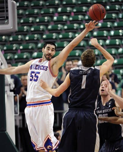 UT Arlington's Jordan Reves (55) blocks a shot by Utah State's Ben Clifford during the second half of a Western Athletic Conference tournament NCAA college basketball game, Thursday, March 14, 2013 in Las Vegas. UT Arlington won 83-78. (AP Photo/David Becker)