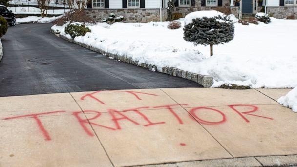 PHOTO: Graffiti is spray painted on the driveway outside of attorney Michael van der Veen's suburban Philadelphia home, Feb. 13, 2021. (Tyger Williams /The Philadelphia Inquirer via AP)