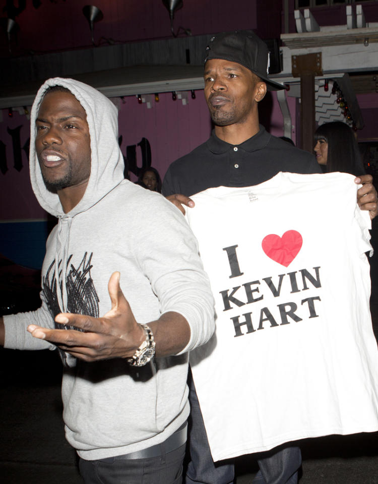 "Hollywood actor Jamie Fox and comedian Kevin Hart were seen leaving Pink Taco's and Jamie was holding a t-shirt the read ""I Love Kevin Hart'' in West Hollywood, CA.