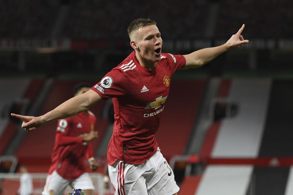 Manchester United's Scott McTominay celebrates his side's second goal during an English Premier League soccer match between Manchester United and Leeds United at the Old Trafford stadium in Manchester, England, Sunday Dec. 20, 2020. (Michael Regan/Pool via AP)
