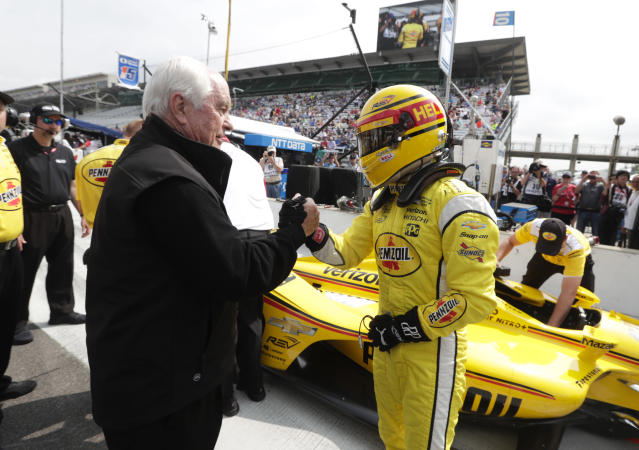 Helio Castroneves, of Brazil, is congratulated by car owner Roger Penske after he qualified for the IndyCar Indianapolis 500 auto race at Indianapolis Motor Speedway in Indianapolis, Saturday, May 19, 2018. (AP Photo/Michael Conroy)