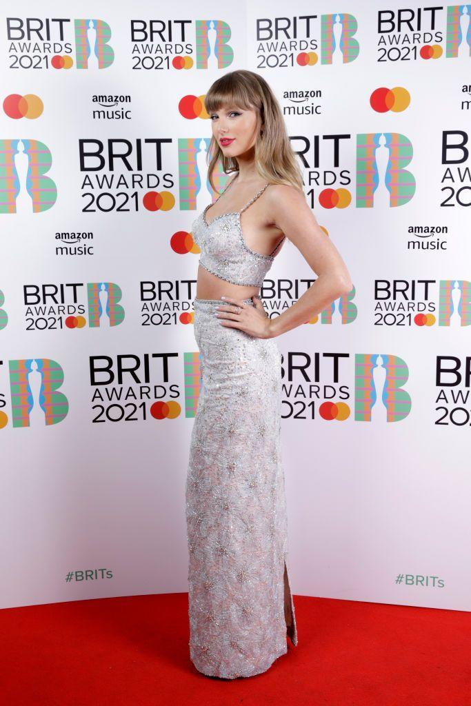 <p>Swift wore a custom-made Miu Miu silver two-piece to collect her Global Icon Award.</p>