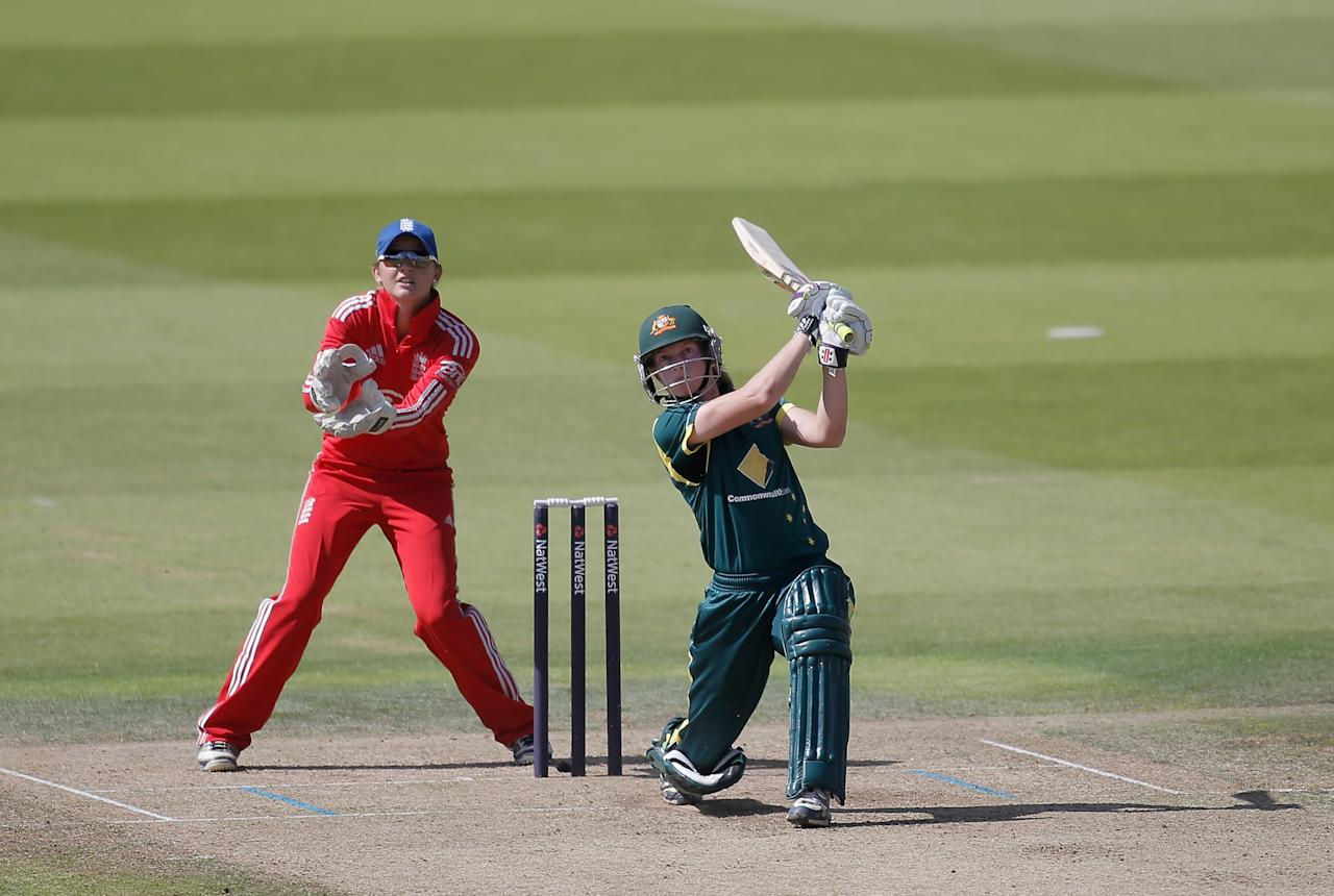 LONDON, ENGLAND - AUGUST 20:  Meg Lanning of Australia hits out watched by England wicketkeeper Sarah Taylor during the first NatWest One Day International match between England and Australia at Lord's Cricket Ground on August 20, 2013 in London, England.  (Photo by Harry Engels/Getty Images)