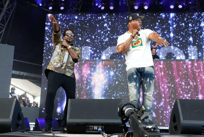 """<span class=""""caption"""">Hip-hop has a long history in referencing space exploration. </span> <span class=""""attribution""""><a class=""""link rapid-noclick-resp"""" href=""""https://www.gettyimages.com/detail/news-photo/tip-of-a-tribe-called-quest-and-ll-cool-j-perform-onstage-news-photo/848179658?adppopup=true"""" rel=""""nofollow noopener"""" target=""""_blank"""" data-ylk=""""slk:Taylor Hill/Getty Images for The Meadows Music & Arts Festival"""">Taylor Hill/Getty Images for The Meadows Music & Arts Festival</a></span>"""