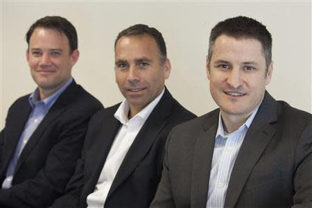 Privateer Holdings executives (L to R), Michael Blue, CFO, Brendan Kennedy, CEO, and Christian Groh, COO, pose for a portrait for Reuters in Seattle Washington July 2, 2013. REUTERS/David Ryder