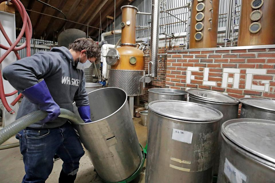 Owner and distiller Brian Ferguson loads a batch of alcohol into a still while making hand sanitizer at the Flag Hill Distillery in Lee, New Hampshire, on May 8. The distillery, which usually produces whisky, rum and vodka, temporarily suspended normal operations to manufacture hand sanitizer. (Photo: ASSOCIATED PRESS)