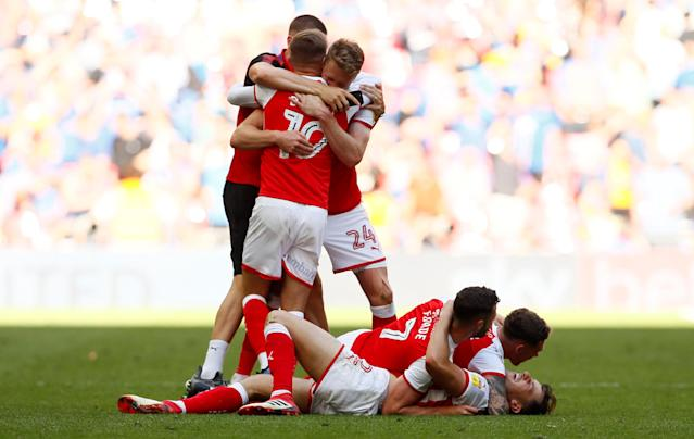 "Soccer Football - League One Play-Off Final - Rotherham United v Shrewsbury Town - Wembley Stadium, London, Britain - May 27, 2018 Rotherham players celebrate promotion to the Championship after the match Action Images/Jason Cairnduff EDITORIAL USE ONLY. No use with unauthorized audio, video, data, fixture lists, club/league logos or ""live"" services. Online in-match use limited to 75 images, no video emulation. No use in betting, games or single club/league/player publications. Please contact your account representative for further details."