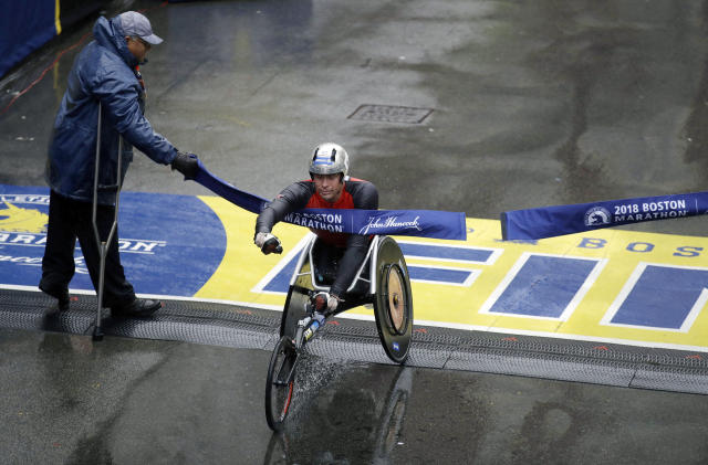 Marcel Hug, of Switzerland, crosses the finish line to win the men's wheelchair division of the 122nd Boston Marathon on Monday, April 16, 2018, in Boston. (AP Photo/Charles Krupa)