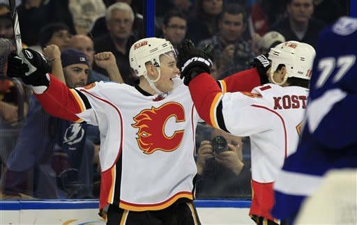 Calgary Flames center Matt Stajan, left, celebrates with teammate Tom Kostopoulos after scoring a goal against the Tampa Bay Lightning during the first period of an NHL hockey game, Thursday, Dec. 15, 2011, in Tampa, Fla. (AP Photo/Chris O'Meara)