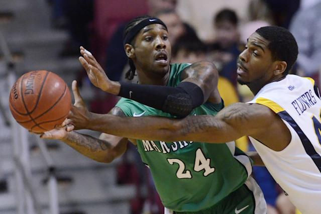 West Virginia's John Flowers, right, looks to knock the ball away from Marshall's DeAndre Kane, Wednesday, Jan. 19, 2011, during the first half of a NCAA basketball game in Charleston, W.Va. (AP Photo/Jeff Gentner)