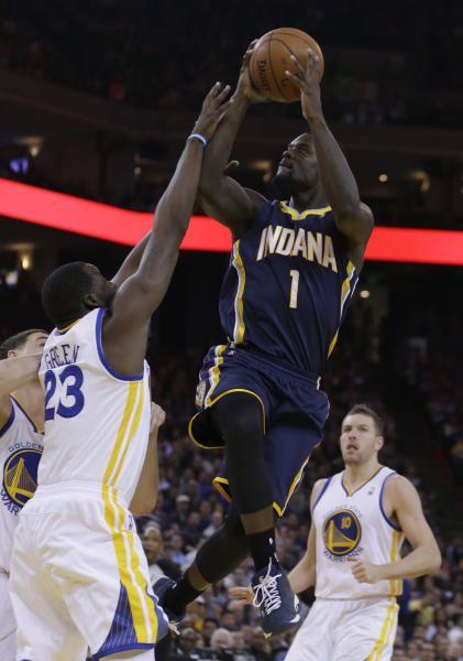 Indiana Pacers' Lance Stephenson (1) shoots against Golden State Warriors' Draymond Green (23) during the first half of an NBA basketball game, Monday, Jan. 20, 2014, in Oakland, Calif. (AP Photo/Ben Margot)