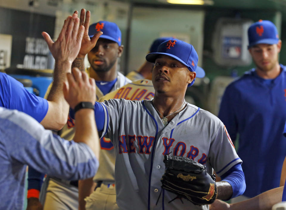 PITTSBURGH, PA - AUGUST 03:  Marcus Stroman #7 of the New York Mets high fives teammates after being relieved in the fifth inning against the Pittsburgh Pirates at PNC Park on August 3, 2019 in Pittsburgh, Pennsylvania.  (Photo by Justin K. Aller/Getty Images)