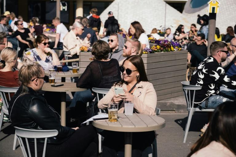 Patios were packed in Finland as bars reopened (AFP Photo/Alessandro RAMPAZZO)