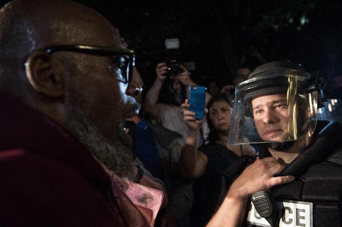 """Hundreds marched to the city police station in Charlotte, North Carolina, on Thursday carrying signs saying """"Stop killing us"""" and """"Resistance is beautiful"""" (AFP Photo/Nicholas Kamm)"""