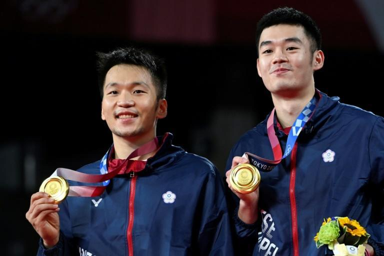 Taiwan's Lee Yang (L) and Wang Chi-lin beat Chinese opposition in the men's doubles badminton final