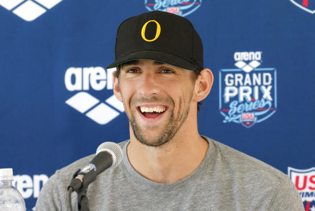 Michael Phelps speaks to the media after the 100-meter butterfly at the Arena Grand Prix swim meet, Thursday, April 24, 2014, in Mesa, Ariz. It is Phelps' first competitive event after a nearly two-year retirement. (AP Photo/Matt York)
