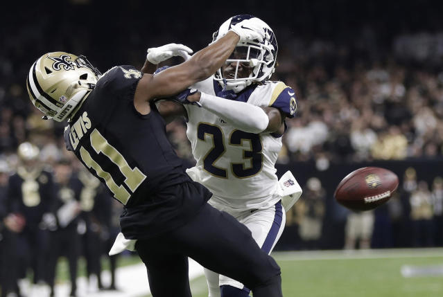 FILE - In this Jan. 20, 2019, file photo, Los Angeles Rams' Nickell Robey-Coleman breaks up a pass intended for New Orleans Saints' Tommylee Lewis during the second half of the NFL football NFC championship game in New Orleans. They were badly burned by the Nola no-call, but the New Orleans Saints have joined the NFL in opposing a fans lawsuit seeking damages over the missed penalty that helped the Los Angeles Rams beat the Saints in a January playoff game and move on to the Super Bowl. (AP Photo/Gerald Herbert, File)
