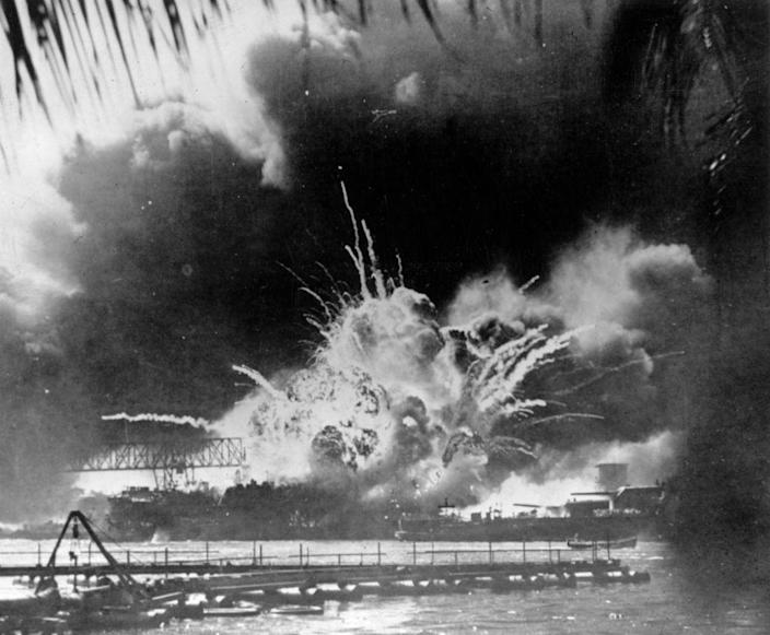 """The USS Shaw exploding during the Japanese attack on the U.S. Pacific fleet at their base in Pearl Harbor on Dec. 7, 1941, on the island of Oahu, Hawaii.<span class=""""copyright"""">Keystone—Getty Images</span>"""