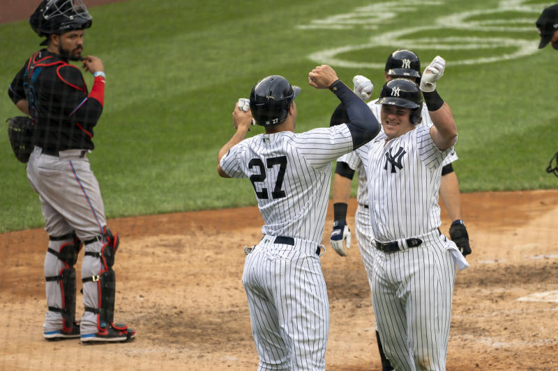 New York Yankees' Luke Voit celebrates a three-run home run with Giancarlo Stanton. (AP Photo/Corey Sipkin)