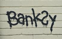A Banksy signature on a mural which was painted on the side of one of the classrooms at Bridge Farm Primary in Bristol during half-term.