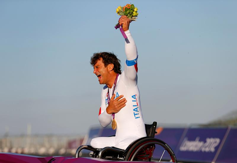 Former F1 and Cart racing car driver Alessandro Zanardi of Italy, celebrates after receiving his gold medal for the Men's Individual H4 Time Trial during the London 2012 Paralympic Games at Brands Hatch racing circuit near Sevenoaks, September 5, 2012. Zanardi, raced cars at Brands Hatch before loosing his legs in a racing accident a few years ago. REUTERS/Andrew Winning (BRITAIN - Tags: SPORT CYCLING OLYMPICS) (Photo: Andrew Winning / reuters)