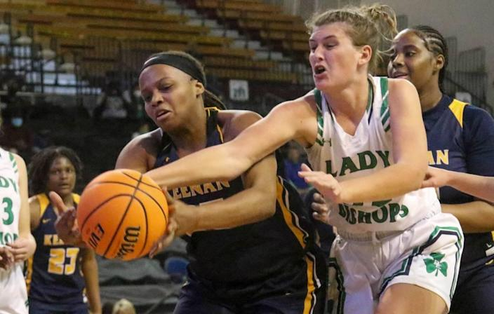 Keenan's Jailyn Oree (35) battles Bishop England's Haley Hubbard (32) for a loose ball during the 3A state championship game at the USC Aiken Convocation Center on Friday, March 5, 2021.