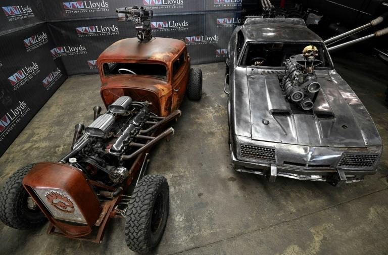 """The Elvis (L) and Razor Cola convoy cars are just two of several outlandish vehicles used in the 2015 dystopian blockbuster film """"Mad Max: Fury Road"""", which are up for bids at Lloyds Auctions in Sydney (AFP/Saeed KHAN)"""