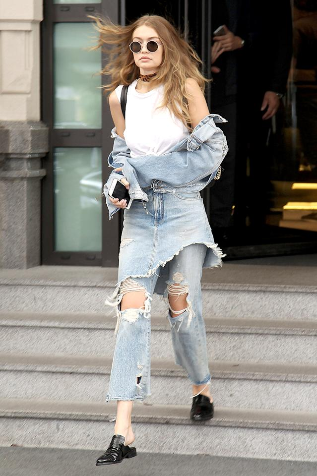 <p>Leave it to Gigi to turn the most basic garments into spectacularly over-the-top ensembles. Do you think anyone has ever worn denim — that is, a denim jacket, a denim skirt, <em>and</em> denim jeans, all at the same time — quite this way? (Photo: AKM-GSI)<br /><br /><br /></p>