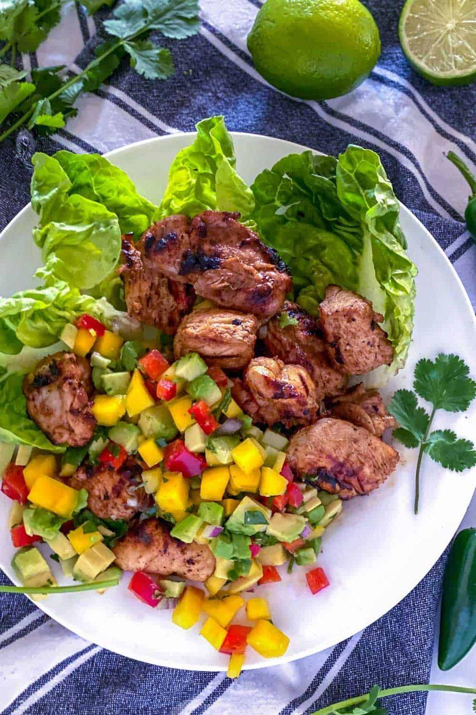 """<p>You'll fire up the grill in the dead of winter to make this tropical-vibed chicken. </p><p><a class=""""link rapid-noclick-resp"""" href=""""https://www.panningtheglobe.com/mexican-spiced-grilled-chicken-nectarine-salsa/"""" rel=""""nofollow noopener"""" target=""""_blank"""" data-ylk=""""slk:GET THE RECIPE"""">GET THE RECIPE</a> </p><p><em>Per serving: 351 calories, 12.8 g fat (2.1 g saturated), 890.2 mg sodium, 23.2 g carbs, 4.3 g fiber, 10 g sugar, 37.2 g protein</em></p>"""