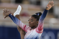 Simone Biles, of the United States, smiles during the warm up prior to the artistic gymnastics balance beam final at the 2020 Summer Olympics, Tuesday, Aug. 3, 2021, in Tokyo, Japan. (AP Photo/Natacha Pisarenko)